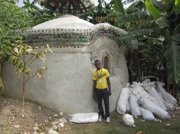 James, one of our guides, poses in front of this house made from plastic bottles.